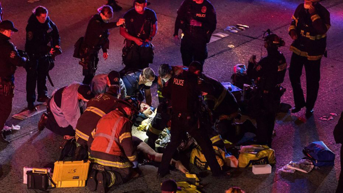Seattle protester hit by car on closed highway dies, second remains in serious condition, officials say